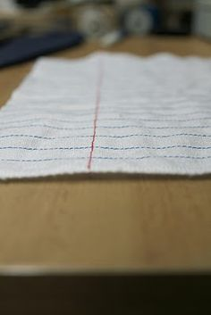 Notebook paper fabric made yourself.   (Note to self...make for a pillow front and then embroider a quote on it.)