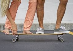 ride a longboard together.