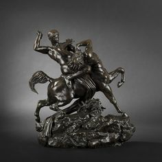 After Antoine-Louis Barye (1796-1875).      Thésée combattant le Centaure Biénor (Theseus Slaying Bienor the Centaur).    Bronze proof with brown patina, signed.    Barbedienne cast, marked.    Height: 55,5 cm (21-3/4 in.) - Width: 49,5 cm (19-1/2 in.) - Depth: 18 cm (7 in.).