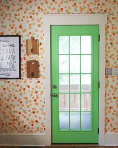 What a cute way to incorporate bright colors into your home. Click through for the tutorial for this hand stamped clementine wall by Elise of A Beautiful Mess. || @Elsie Larson of A Beautiful Mess green doors, hand stamped, inspiration, hands, diy wall art, bedrooms, painted doors, bright colors, kitchen walls