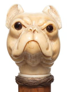 A CARVED IVORY AND WOOD DOG CANE . Circa 1900