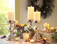 Mercury Glass Candleholders make candles more classy