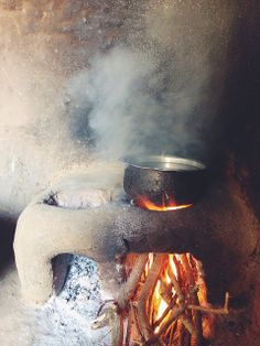 """""""How much grace do you need to boil water? Well…. a lot. It's a journey that starts with an empty castor oil jug, a long walk, a mud stove, and ends in a cup of tea and cookies. It's more than a hike for hot water and cookies, it's about a beautiful and loving life."""" ~JoyTheBaker #CompassionBloggers"""