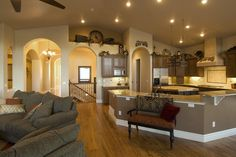 Open living and kitchen like it's one big room where everyone can talk, watch tv, enjoy life.