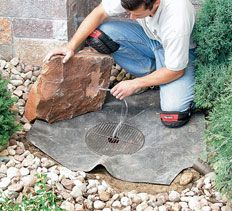 Using a boulder or an artificial rock to create a bubbling rock water feature. Cover the liner with pebbles. Useful if you want a water feature but have young children, so can't have a pool.