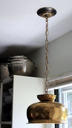 A thrifted brass bowl  made into a pendant.  love this.