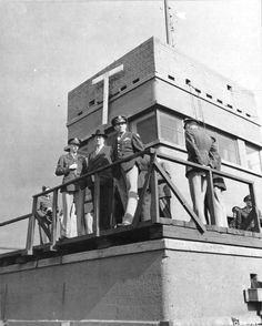 US 4th Fighter Group's control tower at Debden, Essex, England, September 25 1943. Front to Back: BGen Frederick L Anderson, Jr; Mr Donald Nelson, Chief of US War Production; LCol Chesley Peterson, 4th Fighter Group Commanding Officer. (US National Archives) wwii england, air forc, eighth air, daylight raid, war ii, vintag warbird