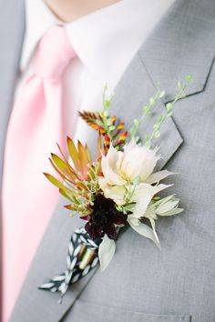 unique groom boutonniere, photo by Jenna Saint Martin http://ruffledblog.com/driftwood-wedding-inspiration #boutonnieres #grooms
