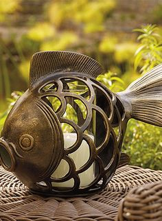 This charming Fish Lantern casts a warm glow across a buffet or table.