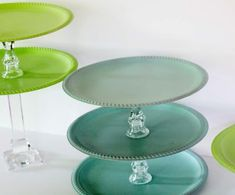 DIY Dollar Store Tiered Party Tray  Items needed:  silver serving trays & crystal candlesticks  from Dollar Store.  Spray paint the trays in whatever colors you would like. Invert the candlesticks between the trays and sper glue in place