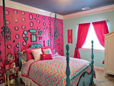 The funky walls, bright colors and beautiful bedding is all stunning! #pink