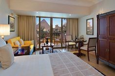 Mena House Oberoi in Giza. Wake up to a view of the Pyramids from your bedroom window.