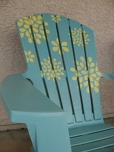 Plastic Adirondack chair, spray Paint and a fun stencil. How cool! Those are kind of ugly, but this would be nice.
