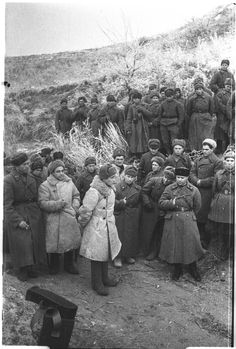 """Battle of Stalingrad: Red Army officer addresses the men of his command in late 1942. The Red Army put special emphasis on the psychological methods used to boost morale and keep front line troops in fighting trim. The effort was also supplemented by the NKVD and the political commissars, who would shoot anyone found to """"avoid"""" his duty to the Motherland."""