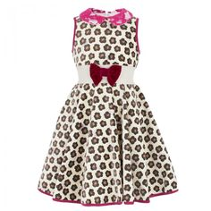 Our look of the day is the Monnalisa Leopard Print Velour Dress. A chic dress for young girls made in Italy from Monnalisa. The design is made of velour leopard print presenting a high fashion look for girls. A standout Peter Pan collar with a fluorescent pink lace and an attached purple waist bow. A classic vintage look for girls featuring an under skirt that flairs at the waist.