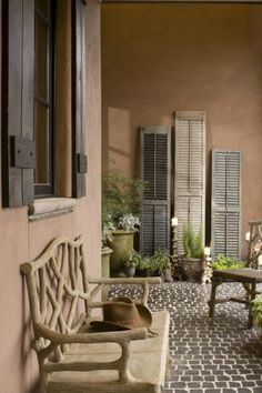 Front patio decor, love the old shutters
