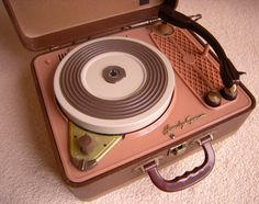 Such a marvelously cute vintage portable record player. #pink #vintage #recordplayer #records #LPs #music