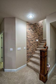 basement stairs leading to main floor; brick wall