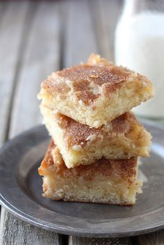 Gooey Cinnamon Squares | Completely Delicious blog - this recipe has a cookie base, a gooey layer, and a topping of cinnamon and sugar