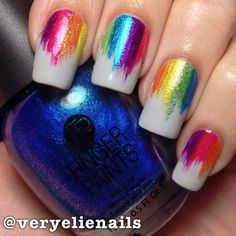 Instagram media by veryelienails  I thought this would be done differently to how it was; I assumed it was nail glue swiped down the nails + coloured foil, but it's just metallic/shimmery polishes swiped on. Either way it's gorgeous