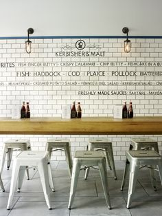 Let the fish  chips do the talking! I love the simplicity of this space- the tiles, the typography, the industrial wall lights and, of course, the Tolix stools