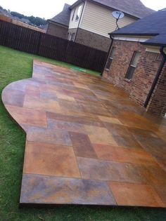 Acid stained, stamped concrete made to look like slate.  I want to do this inside my house