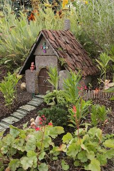Fairy garden house made out of cinder blocks. ROOF FENCE