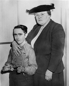 Deputy Sheriff Clemmia A. Hurst, of Lee County, Kentucky, posing with her prisoner, Raney Allen, before boarding a bus that would take them to Beatyville, Ky, where he was wanted on a murder charge. Despite looking quite young, Allen was actually 25-years-old. The picture was taken on Oct. 17, 1945.
