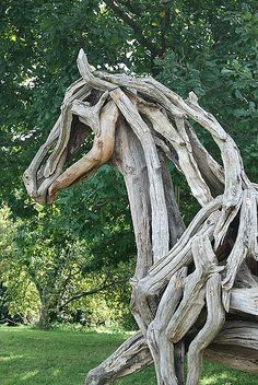 Horse sculptures made out of driftwood.
