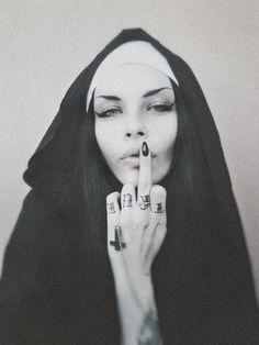 Jenny Cat, Nunsploitation † #nun #habit #tattoos #cross #crucifix #invertedcross #middlefinger #fuckoff #religious #iconography #nunsploitation #JennyCat