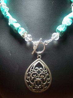 I like the idea of the clasp at the pendant. Homemade Jewelry...check out her others