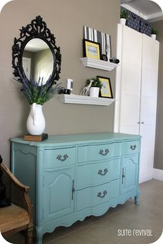 how to decorate above the dresser  color is aqua...love it for my tv stand
