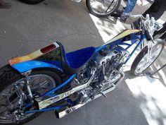 shovelhead hardtail digger with blue velvet seat, springer front end and hexagonal megaphone exhaust