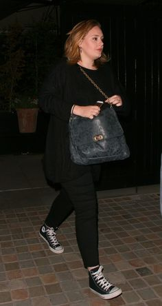Spotted: Adele rocks some Chuck Taylors for a night out in London on June 14