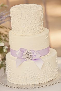 white cake w/ purple ribbon, simple and cute:)