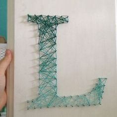 This could be cool to add into a room setting. nail and string letter -Etsy