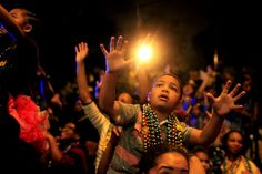 Mardi Gras through the eyes of a child, in this case a young boy up on a parent's shoulders, begging for Bacchus beads.