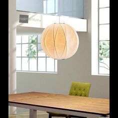 Simply, modern lighting is created with the Coriolis Ceiling Lamp, an elegant lamp draped in silk.