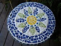 Mosaic Tabletop - gonna do this with a thrift store end table I found. Going to use an old broken mirror and maybe shells collected from Gulf Shores?