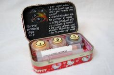 i made my craft partner a purple smokey eyshadow kit in an altered altoid tin. everything is handmade, from the eyshadow to the lipbalm