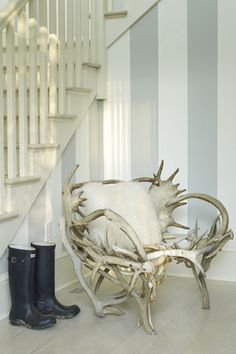 antler chair - the mostly white, pale, environment makes the antler chair a piece of art, a sculpture... beautiful