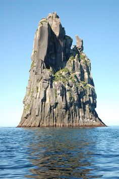 """Tell me your first thought isn't,   """"What a perfect spot for my secret evil lair!""""    A rock near Urup. Urup is an uninhabited volcanic island in the south of the Kuril Islands chain in the Sea of Okhotsk (northwest Pacific Ocean)."""