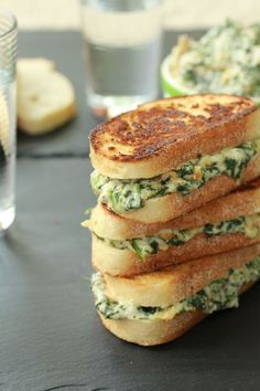 Spinach & artichoke grilled cheese sandwich.. Cut in half and they make a delicious appetizer!