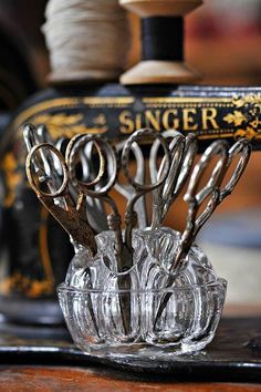 Gorgeous scissors collection in a glass frog and the Singer in the back!   great idea for the sewing room