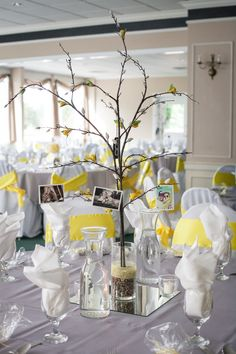 DIY wedding centerpiece, branches, pictures, and crepe paper flower buds, yellow & Gray wedding