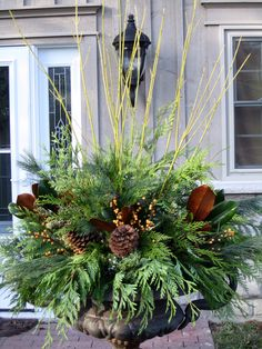Winter urn with green dogwood branches