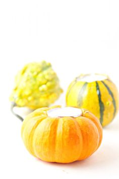 These DIY gourd candles are perfect for any fall entertaining you may be doing. You can pick up a bag of gourds and everything else you need for this project at your local  Lowe's.