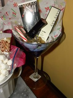 Lip-Tini: Mary Kay Lip Balm, Mary Kay lip stick, chocolate kisses and a Martini glass. $27 add the lip mask for $10 more.