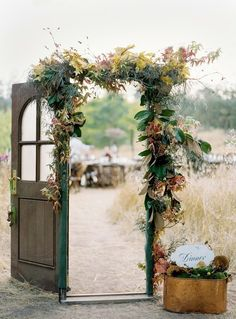 door installation with flowers. the doors, outdoor ceremony, reception ideas, garden doors, the bride, decorated doors, backyard gardens, outdoor weddings, vintage doors