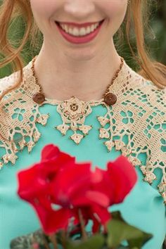 I love the elegant button on the front of this filet crochet shawl.  Eolande Neck